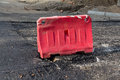 Red plastic fence with road repairs