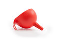 Red plastic funnel on white background isolated Stock Photos