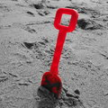 Red Plastic Spade on Beach Royalty Free Stock Photo