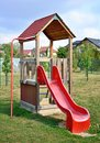 Red playground slide Royalty Free Stock Photo