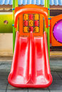 Red playground slide for small children Royalty Free Stock Photo