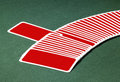 Red playing cards Stock Images