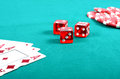 Red poker gambling chips on a green playing table Royalty Free Stock Photos