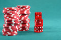Red poker gambling chips on a green playing table Royalty Free Stock Images