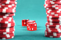 Red poker gambling chips on a green playing table Royalty Free Stock Photography