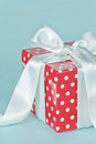 Red polkadot gift box with white bow Royalty Free Stock Photos