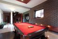 Red pool table a big in a luxurious interior Stock Image