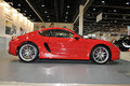 Red porsche cayman at the show car pavilion in abu dhabi international hunting and equestrian exhibition adihex in adbu dhabi Stock Photos