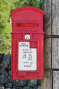 Red post box scottish highland attached to telegraph pole from s period only day there is no collection is new years day Stock Image