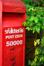 Red post box set against nature background at chiang mai thailand Royalty Free Stock Photos