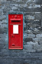 Red post box set in wall old english a Royalty Free Stock Image