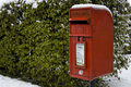 Red post box in the snow Stock Photos
