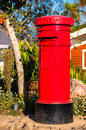 Red post box the is standing alone Stock Photos
