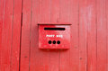 Red post box on wall Stock Photography
