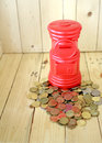 Red post office coin tube financial concept Stock Photography