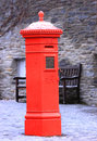 Red postal box old english style mailbox in a snow covered square in new zealand Stock Images