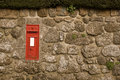 Red Postbox in English Village Wall Royalty Free Stock Photography