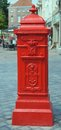 Red postbox Royalty Free Stock Photo