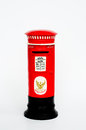 Red postbox on white ground