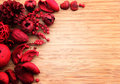 Red potpourri on wood with copy space Stock Image