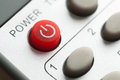 Red power button on the remote control close up Stock Photo