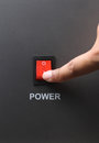Red power switch asian male hand turning on Royalty Free Stock Photo