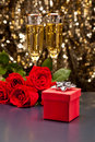 Red present box Champagne and roses Stock Photos