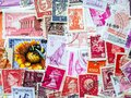 Red and purple vintage postmarks, stamp collecting. Hobby and philately concept Royalty Free Stock Photo