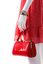 Red purse in mannequin s hand female with glossy handbag dotted dress and glossy bag bright bag from new collection Stock Photography