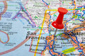 Red pushpin on a map making the destination of journey Royalty Free Stock Photography