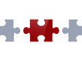 Red puzzle piece among white ones shiny and pieces on both sides isolated on background Royalty Free Stock Photography