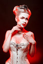 Red queen with a crown and a corset with make up in studio shot Royalty Free Stock Images
