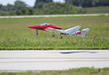 Red radio controlled airplane takeoff taking off on the landing strip national model aviation day Stock Images