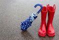 Red rain boots and umbrella