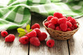 Red raspberries on grey wooden background Stock Images