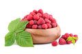 Red raspberries heap of with green leaves on white background Royalty Free Stock Photos