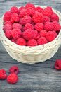 Red raspberries. Ripe berry in wicker basket. Raspberries in basket on the table Royalty Free Stock Photo