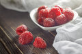 Red raspberries in white bowl Royalty Free Stock Photo