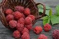 Red raspberries on a wooden board in wicker basket Stock Photos