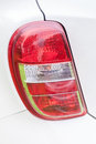 Red rear lights of a white car Royalty Free Stock Photo