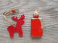 Red reindeer and candle Stock Photography