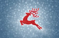 Red reindeer moose jumping on snow background