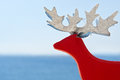 Red reindeer on vacation by the sea Stock Photo