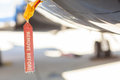 Red Remove Before Flight Tag on an airplane fuselage Royalty Free Stock Photo