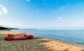 Red Italian rescue boat for tourists on a sandy beach. Royalty Free Stock Photo