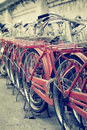 Red retro bicycle parking on street Stock Photo