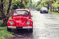 Red retro car on the street Royalty Free Stock Photography