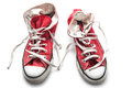 Red retro sneakers on white background Royalty Free Stock Photo