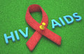 Red ribbon aids symbol of a commitment to the fight against hiv Royalty Free Stock Images