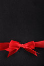 Red ribbon on the bottom of black leather Royalty Free Stock Photo